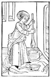 Kobieta wytwarzająca masło