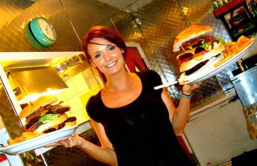 Lady serving burgers