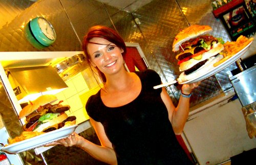 Lady serving burgers